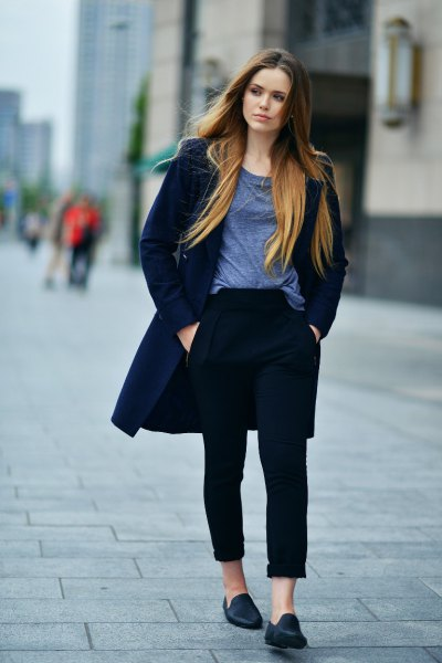 navy blue long-line jacket with black cuffed jeans and casual loafers