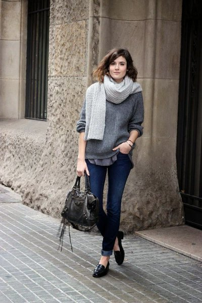 blue ribbed chunky sweater with black casual loafers