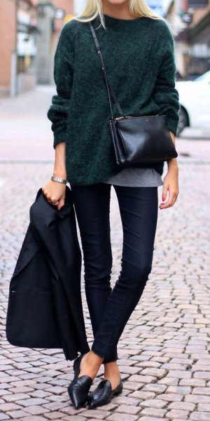 black knit chunky sweater with dark jeans and leather case