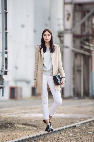 blush pink long wool coat with cuffed white jeans