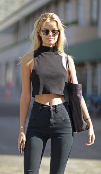 black suede sleeveless crop top with matching slim jeans