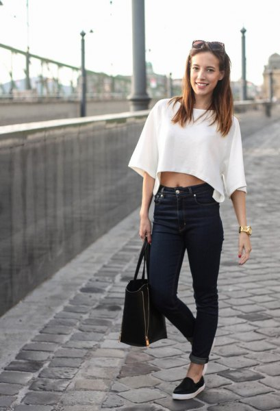 white short-sleeved cropped top with cuffed jeans and canvas loafers