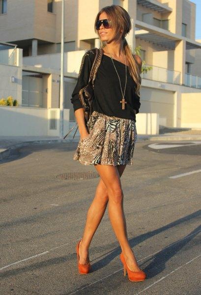 black of the shoulder blouse with printed mini skater skirt and orange heels
