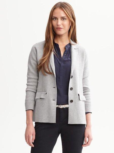 light gray sweater-blazer with dark blue collar-free button up shirt