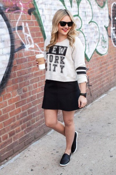 white print sweater with black mini skirt