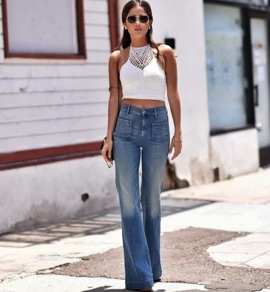 white cropped make-up top with blue front pocket cut jeans