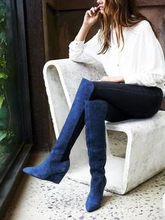 white button up shirt with blue over knee suede boots
