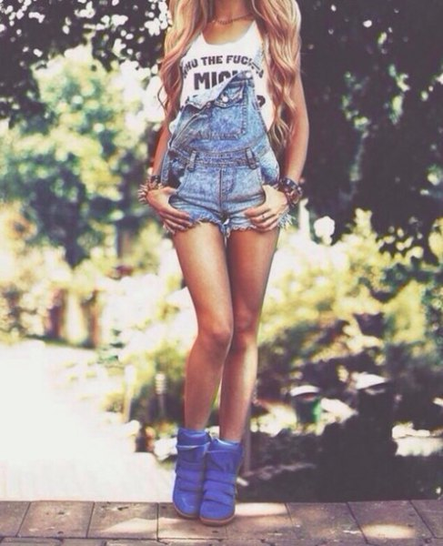 blue jeans in overall shorts with royal blue leather boots