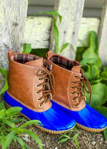 brown and royal blue color block ankle boots with slim jeans