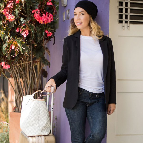 black casual blazer with dark blue skinny jeans and knitted hat