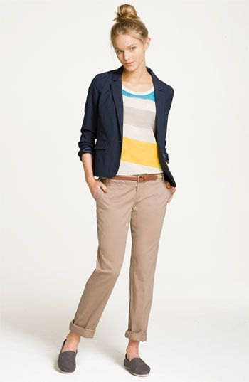 rainbow sweater with navy blue blazer and cropped trousers