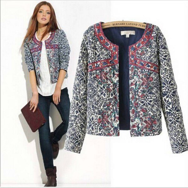 gray printed shirt jacket with white blouse and dark jeans