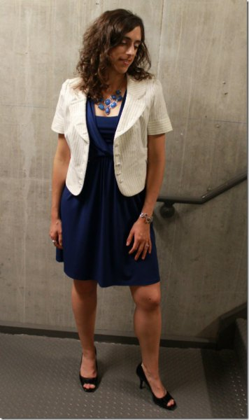 white short sleeved blazer with black mini swing dress