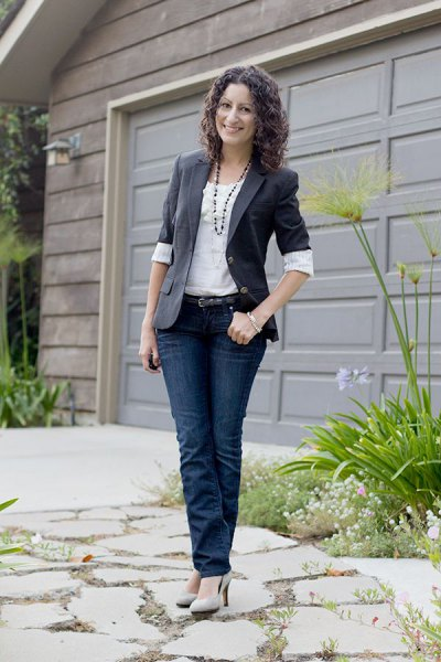 gray half-heated blazer with white blouse and dark jeans