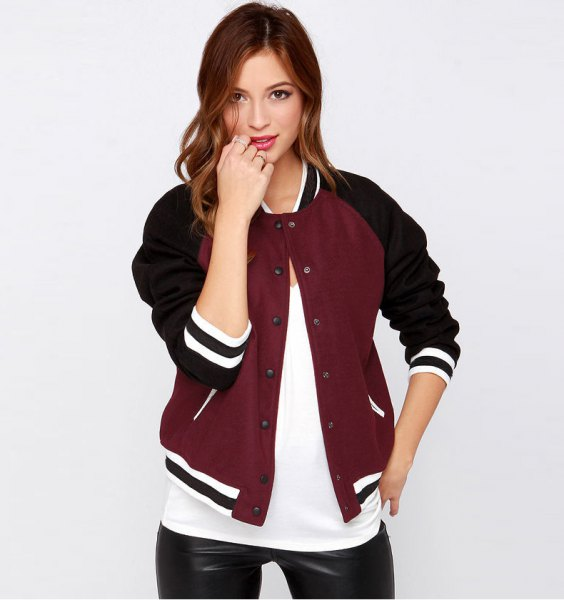 black and burgundy casual baseball jacket with white tee and leather leggings