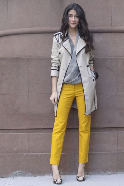 light gray trench coat with yellow ankle trousers