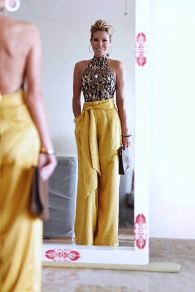 silver sequin gate with top with tie in waist yellow wide leg trousers