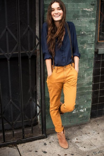 navy button up linen shirt with mustard cuffs and boots