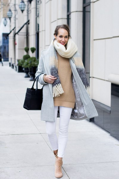 light gray cocoon coat with pink sweater and white cropped jeans