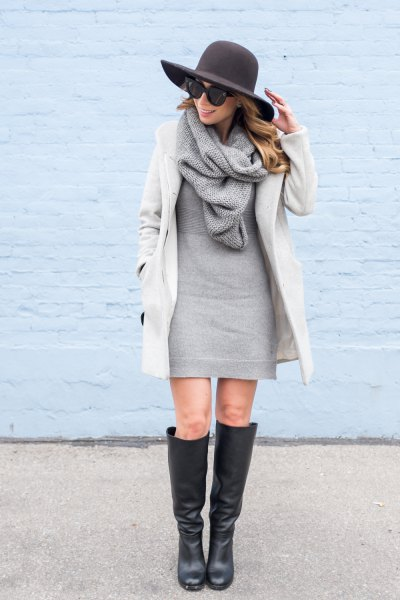 white cocoon coat with gray sweater mini dress and knitted scarf