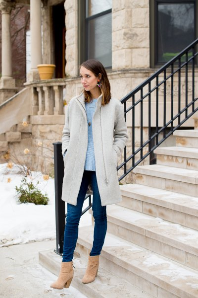 light gray long jacket with sky blue sweater and skinny jeans