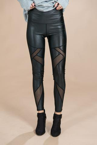 black printed half leather leggings with light gray long sleeve tee