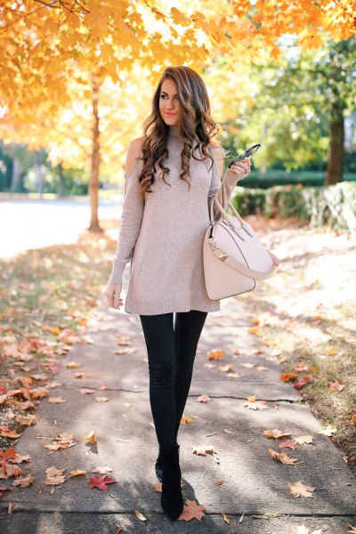 gray cold shoulder tunic sweater with black plaid leggings