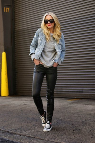 blue denim jacket with black leggings and canvas sneakers