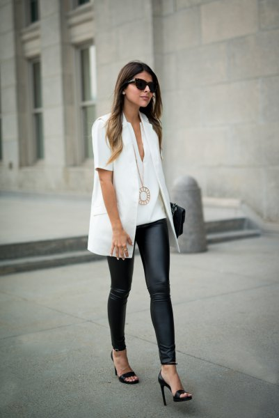 white short sleeve shirt with black leggings and heels