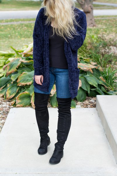 navy blue ribbed cardigan with skinny jeans and high thigh boots