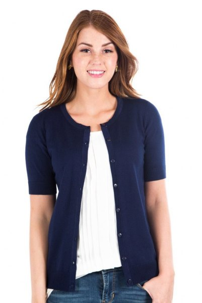 navy blue cardigan with white pleated blouse