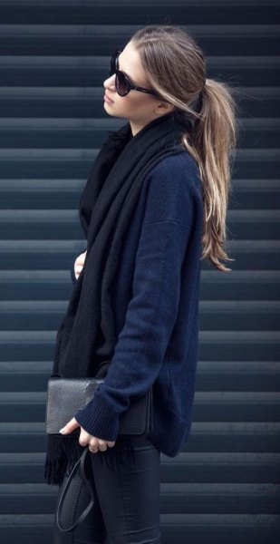 navy blue cardigan with black long scarf and leather pants