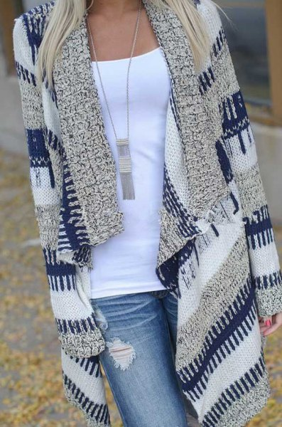 navy and gray striped longline sweater cardigan with light blue ripped jeans