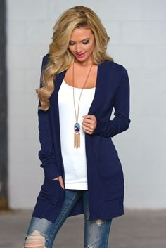 navy blue cardigan with white top with shoe neck and boho necklace