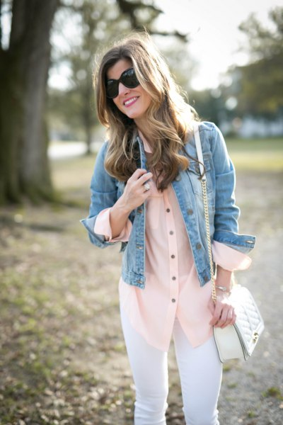 blue denim jacket with red silk blouse and white jeans
