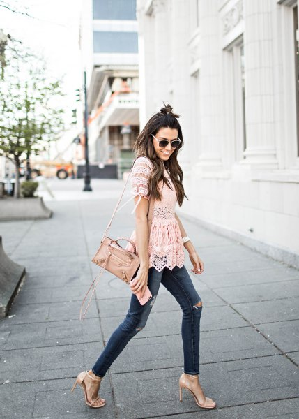 blush lace peplum peeled hem with dark skinny jeans