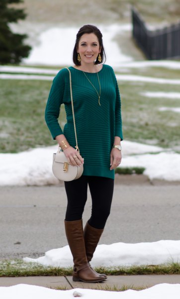 long sleeved striped sweater with black leggings and brown leather shoes