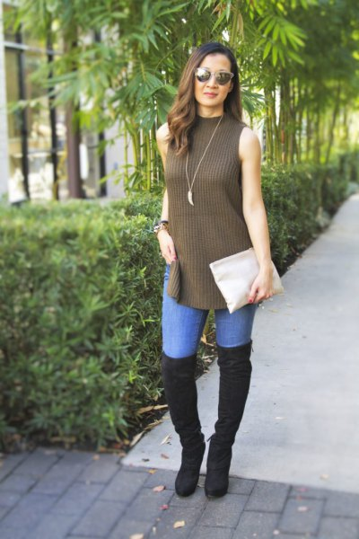 green mock neck ripped long sweater with black thigh high boots