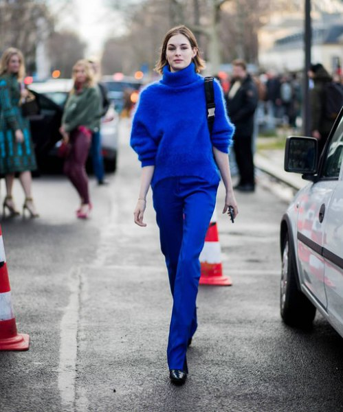 royal blue turtleneck chunky sweater with matching straight jeans