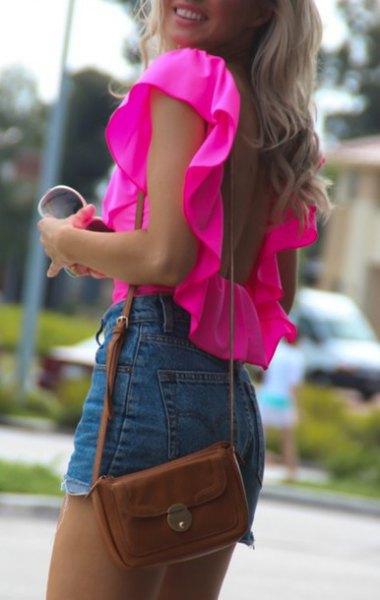 warm pink ruffle shoulder sleeveless blouse with high-rise denim shorts