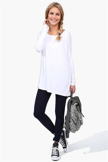 white tunic long sleeve tee with black ankle jeans