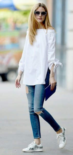 white from the shoulder long blouse with ripped ankle jeans