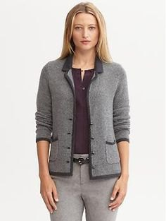gray knitted blazer with black top and skinny pants in cotton