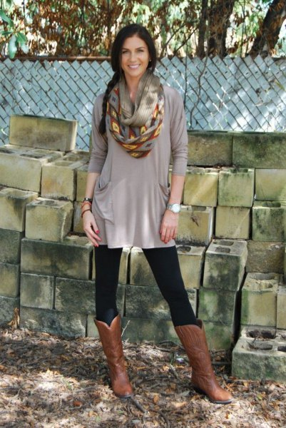 gray dress with tunic with leggings and knee-high boots in brown leather