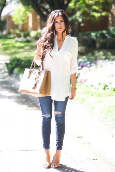 white dress button up tunic top with blue ripped skinny jeans