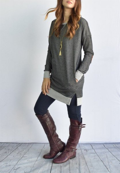 gray blue tunic top with dark skinny jeans and knee-high boots in leather
