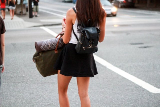 white top with mini skater skirt and black backpack