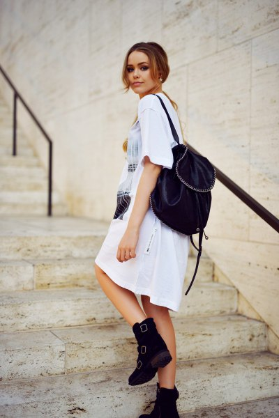 white printed t-shirt dress with ankle boots with velvet backpack