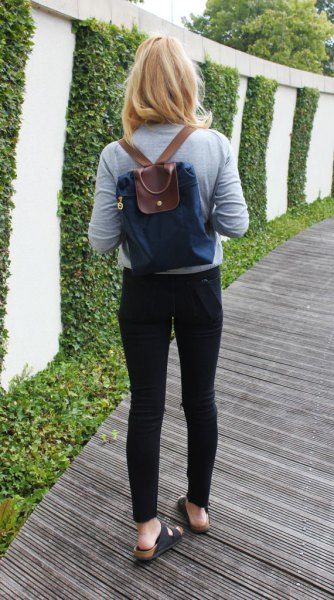 navy and brown backpack bag with gray long sleeve tee