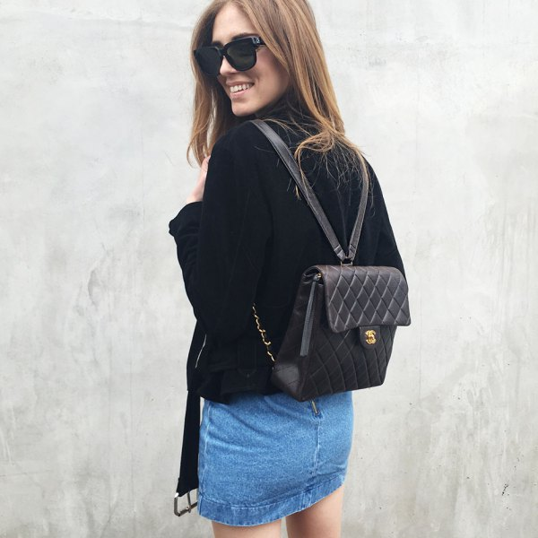 black quilted leather backpack with velvet jacket and denim mini skirt